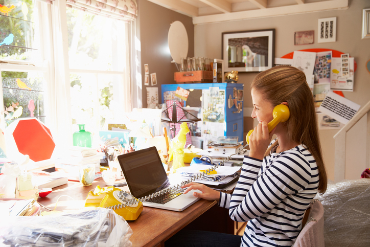 home business woman at cluttered desk